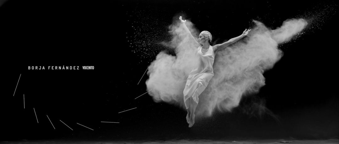 IMAGE: Still – female dancer throwing flour