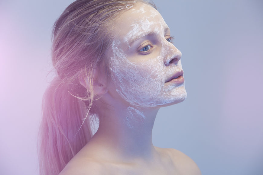 IMAGE: Photography - Blue-tinted woman with face mask